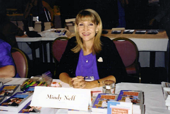 Mindy at the Literacy signing at the RWA National convention.
